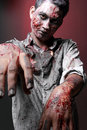 Zombie standing looking camera two hand close up Royalty Free Stock Photo