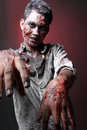 Zombie standing looking camera two hand close up scariied Royalty Free Stock Photos