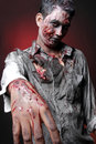 Zombie standing rise hand and looking camera Royalty Free Stock Photo