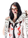 Zombie woman with facial injuries blood stained dress and a stream of forged dollar bills on white background Royalty Free Stock Photo
