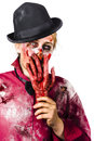 Zombie woman holding bloody hand a to her face Stock Photography
