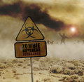 Zombies desert sign approaching through misty with warning in foreground Stock Photos