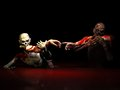 Zombies eating creation two undead bloody arms in the iconic michelangelo of adam pose Stock Image