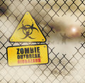 Zombies fence approaching with warning sign Royalty Free Stock Images