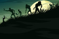 Zombies walking down the hill in the mist on a full moon Royalty Free Stock Photo