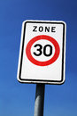 Zone slow and safe driving in a km h or mph Royalty Free Stock Photos