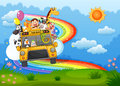 A zoo bus at the hilltop with a rainbow in the sky Royalty Free Stock Photography