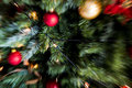 Zoom blast motion blur shot of red and gold christmas decorati Royalty Free Stock Photo