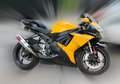 Zoom in motorcycle side view yellow Stock Photography