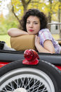 Zoomed woman relay at car seat back retro Royalty Free Stock Photography