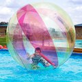 Zorbing entertainment on water boy in a ball the Stock Photography