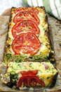 Zucchini and bacon slice topped with tomatoes straight out of the baking tin Royalty Free Stock Photography