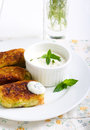 Zucchini crocketts with minted yogurt on plate Royalty Free Stock Photos