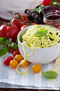 Zucchini noodles in a bowl with fresh vegetables Royalty Free Stock Photo