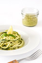 Zucchini noodles with pesto sauce isolated on white background Royalty Free Stock Photo
