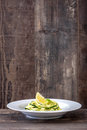 Zucchini noodles with pesto sauce on wooden table Royalty Free Stock Photo