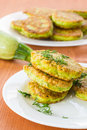 Zucchini pancakes fried fritters with dill on a plate Royalty Free Stock Image