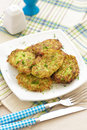 Zucchini pancakes on a plate close up Royalty Free Stock Images
