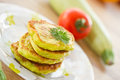 Zucchini pancakes on a plate with greens Royalty Free Stock Image