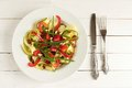 Zucchini salad on white plate Royalty Free Stock Photo
