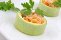 Zucchini stuffed with vegetables with rice and cheese ring of Royalty Free Stock Photos