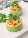 Zucchini stuffed with vegetables with rice and cheese ring of Royalty Free Stock Images