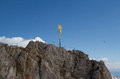 Zugspitze summit cross golden on the of a mountain Stock Photo