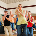 Zumba or Jazzdance - people dancing in studio Royalty Free Stock Image