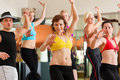 Zumba or Jazzdance - people dancing in studio Stock Photography