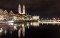 Zurich on banks of limmat river at winter evening switzerland Royalty Free Stock Photo