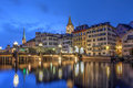 Zurich switzerland twilight scene in with the old city reflecting in the waters of limmat river as it flows into the lake Royalty Free Stock Photo