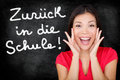 Zuruck in die schule german student back to school screaming happy written on blackboard by female teacher smiling happy Stock Image