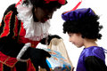 Zwarte Piet ( black pete) with young chi Stock Photos