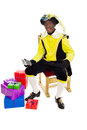 Zwarte piet sinterklaas black pete clipping path included with calculator typical dutch character part of a traditional event Royalty Free Stock Photo
