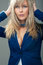 Stock Image :  Ελκυστική επιχειρησιακή γυναίκα στη μπλε ζακέτα
