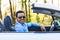 Stock Image :  Μαύρος λατινοαμερικάνικος οδηγός που οδηγεί το νέο αυτοκίνητό του