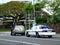 Stock Image :  Ο αστυνομικός Αστυνομίας της Χονολουλού τραβά πέρα από το αυτοκίνητο SUV επάνω