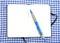 Stock Image :  Σημειωματάριο στο ύφασμα