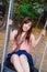 Stock Image : Азиатская девушка играя качание