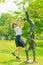 Stock Image : Милая тайская школьница скачет с статуей