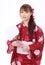 Stock Image : Молодая азиатская женщина в кимоно