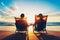 Stock Image : Пары наслаждаясь заходом солнца на пляже