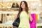 Stock Image :  Покупки молодой женщины в моле