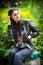 Stock Image : Портрет красивой женщины с длинными волосами и кожаной курткой
