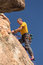 Stock Image :  Старший человек наверху подъема утеса в Колорадо