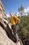 Stock Image :  Старший человек начиная подъем утеса в Колорадо