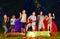 Stock Image :  Счастливые дети танцуя вокруг лагерного костера
