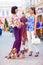 Stock Image :  Счастливые женщины идя собаки на улице города