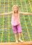 Stock Image :  孩子-女孩支持的净梯子
