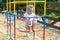 Stock Image : Active little girl on summer playground